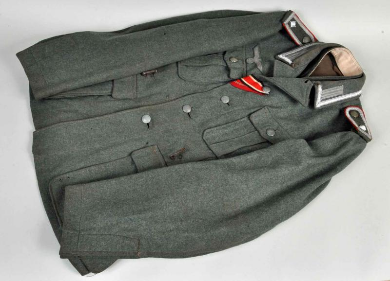 GERMAN WWII ARMY M.40 ARTILLERY ENLISTED MANS COMBAT TUNIC.